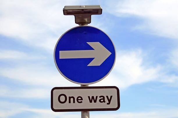 A sign that says one way with and arrow pointing/humbling ourselves
